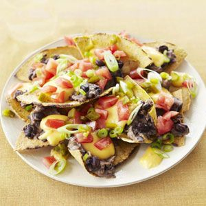 "<p>Celebrate Cinco de Mayo with a Tex-Mex treat that has fewer than half the calories of one food celebrity's version.</p><br />  <p><b>Recipe: <a href=""/recipefinder/nachos-supreme-recipe-ghk0511"">Nachos Supreme</a></b></p>"