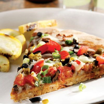 "<p>Break out the napkins! This pie is an over-the-top vegetarian concoction with black-bean spread, Jack cheese, tomatoes, scallions, olives, and pickled jalapeños.</p><br /> <p><b>Beer Pairing:</b> Spicy foods need spicy beers — go for an India Pale Ale (IPA). If you're not a hop-head, the malty sweetness of brown ales works well with the sweeter elements on the pizza.</p><br /> <p><b>Recipe: </b><a href=""/recipefinder/black-bean-nacho-pizza-recipe-9898"" target=""_blank""><b>Black Bean Nacho Pizza</b></a></p>"
