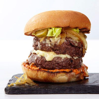 """<p>Topped with a mix of shredded cheddar and Gruyère, Chef Ron Boyd serves this over-the-top bar burger at Daniel Patterson's new restaurant Plum, in Oakland, CA.</p><p><strong>Recipe:</strong> <a href=""""../../../recipefinder/double-cheeseburgers-caramelized-onions-recipe-fw0612"""" target=""""_blank""""><strong>Double Cheeseburgers with Caramelized Onions</strong></a></p>"""