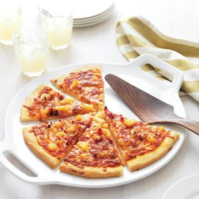 "<p>Kids will love making and eating this fun pizza. The ham and pineapple give a unique spin on pizza.</p><p><b>Recipe:</b> <a href=""http://www.delish.com/recipefinder/ham-pineapple-pizza-recipe-del0312"" target=""_blank""><b>Ham and Pineapple Pizza</b></a></p>"