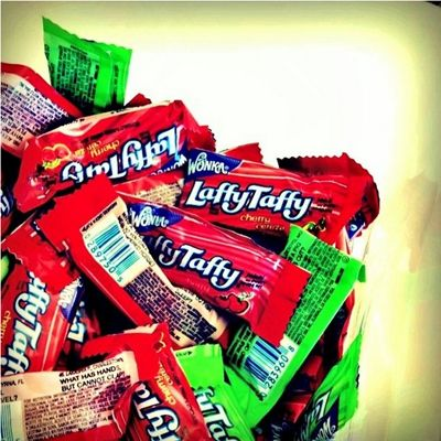 <p>Why did the chicken cross the road? To get to the Laffy Taffy! Laffy Taffys were actually introduced by the Willy Wonka Candy Company in the 1970s, but we all gobbled them down like, well, candy in the 90s. These individually wrapped, chewy, tongue-stainingly colorful taffys had jokes written on the wrappers, written by taffy-consuming child pun prodigies. Although Laffy Taffys are still on the market, but they don't make 'em like they used to -  literally, because the candies used to be short and fat, and now they're longer and flatter, and sometimes have sparkles.</p>