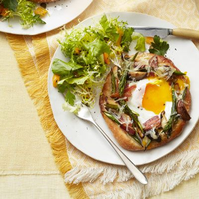 "<p>Skip your typical breakfast sandwich and try these mini breakfast pizzas instead. Serve pizzettes with a simple <a href=""/recipefinder/escarole-frisee-salad-recipe-ghk0512""><b>Escarole Frisée Salad</b></a> (pictured).</p><p><b>Recipe: <a href=""/recipefinder/asparagus-fontina-pizzettes-bacon-recipe-ghk0512"">Asparagus-Fontina Pizzettes with Bacon</a></b></p>"