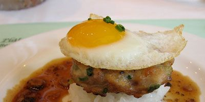 <p><b>Loco Moco, Hawaii</b></p> <p>One of Hawaii's most popular comfort foods, the loco moco consists of white rice topped with a hamburger patty, a fried egg and brown gravy. The dish debuted in 1949 at Lincoln Grill in Hilo, where it was served for 25 cents. Lincoln Grill has since shuttered, but chef Sam Choy offers a stellar traditional version at his Kai Lanai restaurant on the Big Island. </p>