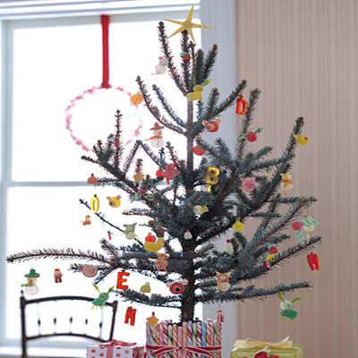 <p>Christmas candy can be turned into fun and enchanting decorations that children will love to help create. Candy canes, gumdrops, and peppermints become Christmas tree ornaments, snowmen, reindeer, cottages, and much more.</p><p> Gumdrops, gummy worms, sour tape, and other gummy candies don't need any royal icing or glue to be assembled into ornaments. The candies are cut with a plastic knife to expose their sticky interiors, which provide all the sticking power you need to create snowmen, Santas, carolers, birds, and more.</p><p><b>How to Make the Candy Tree</b></p><p> Candies:</p><p>  Choose the colors, shapes, and sizes that suit the objects or animals you wish to create. Just remember to choose candies with a gummy consistency and to connect them by their sticky surfaces.</p><p>  To make the candy caroler below, we used a chewy red-and-white column for the body, a sour gummy worm for the scarf, a gumdrop for the head, an uncoated gumdrop for the hat, and nonpareils for the eyes and mouth.</p>  <p><b>Techniques:</b></p>  <p>We used just six techniques to create all sorts of ornaments.</p>  <p>1. Cutting:</p> <p>Use ordinary scissors to cut out chewing-gum ears. Snip licorice twists, which are hollow, to form candy beads. Cut thin strips of the twists lengthwise to make skinny antlers and legs.</p>  <p>2. Slicing:</p> <p>Use a plastic knife to slice through a gumdrop, exposing its stickiness so another candy (if it's gummy, slice it, too) will adhere. When possible, apply sticky to sticky.</p>  <p>3. Poking:</p> <p>A toothpick is best for poking a little hole in candy before adding nonpareil eyes and mouth. The toothpick's tip will turn sticky — helpful when transporting the nonpareil. Use a clean toothpick to remove the nonpareil from the sticky toothpick.</p><p>  4. Cookie-Cutter Cutting:</p> <p>Use a cookie or aspic cutter to cut shapes from gum and sour tape.</p>  <p>5. Slitting: To stick flat candies into a gumdrop for ears or leaves, make incisions in drop with a plastic knife and then insert the candy.</p>  <p>6. Hanging: Parents should help with wires. Insert wire (we used 24-gauge) through ornament, from top to bottom, until end pokes out. Using your fingers, or needle-nose pliers, bend the bottom at a right angle and clip off the extra with a nail clipper. Bend the top end into a hook. Let heavier ornaments set for three days before hanging; they will harden, tightening around the wires.</p>