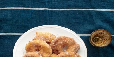 """<p>Try a seasonal twist on Hanukkah's fried food tradition with these indulgent apple fritter.</p><p><b>Recipe: </b><a href=""""http://www.delish.com/recipefinder/apple-fritter-rings-recipe-mslo1212"""" target=""""_blank""""><b>Apple Fritter Rings</b></a></p>"""