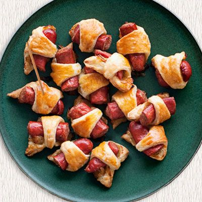 "<p>Caramelized onions and hot dogs are finger-food ready when wrapped in rich butter pastry.</p><p><b>Recipe:</b> <a href=""/recipefinder/pigs-in-a-blanket-recipe-opr0211"" target=""_blank""><b>Pigs in a Blanket</b></a></p>"