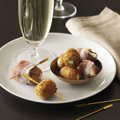 """<p>Start a romantic Valentine's Day dinner with Giada DiLaurentiis's gorgonzola cheese- and thyme-stuffed fried olives (pictured with Giada's Cheese-Stuffed Dates with Prosciutto).</p><br /><p><b>Recipe:</b> <a href=""""/recipefinder/italian-fried-olives-recipe-rbk0211"""" target=""""_blank""""><b>Italian Fried Olives</b></a></p>"""