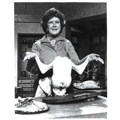 <p>Everyone has a favorite Julia Child moment, saying, or comedic culinary foible. She was famous for delivering personal cooking lessons through the magic of television. The upbeat chef educated Americans about foods beyond meat and potatoes and let them know that mistakes are part of cooking. While wielding knives and cleavers, she showed viewers how to cut up swordfish, used her body to explain cuts of beef, and never feared reaching into a chicken carcass to grab the giblet.</p> 
