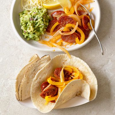 """<p>Serve this spicy sausage-and-pepper sauté in <a href=""""/recipefinder/build-your-own-tacos-recipe-rbk0910"""">build-your-own-tacos</a> with assorted salsas and toppings.</p> <p><strong>Recipe:</strong> <a href=""""../../../recipefinder/chorizo-tacos-recipe-rbk0910"""" target=""""_blank""""><strong>Chorizo, Onions, and Peppers Tacos</strong></a></p>"""