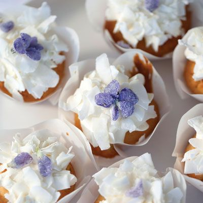 "<p>""Like tiny snowcapped mountains, these cupcakes capture your heart. They look delicate and airy but have the texture and crumb of a perfect pound cake, with a sweet violet jam surprise inside."" — Miche Bacher</p> <p><strong>Recipe:</strong> <a href=""../../../recipefinder/violet-flower-cupcakes-recipe-del0313"" target=""_blank""><strong>Violet Flower Cupcakes</strong></a></p>"