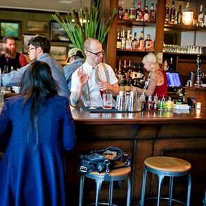 Portland, Oregon <br /><br /> You're having: a pint of cask ale, a half dozen raw oysters <br /><br /> The Woodsman Tavern is like a rich man's hunting lodge: rustic but not too rustic and conspicuously well stocked with the good things in life: numerous Belgian beers on tap, cask ales, well-made cocktails, raw oysters and clams, a selection of country hams, carefully chosen wines and spirits. It would almost make you tired—if it weren't all so damn good. <br /><br /> 4537 Southeast Division Street; 971-373-8264