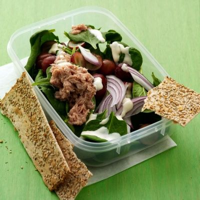 """<p>The three components of this salad can be readied ahead of time and later mixed together for a healthful lunch. For the freshest tasting salad, open the can of tuna right before serving.</p> <p><br/><strong>Recipe:</strong> <a href=""""http://www.delish.com/recipefinder/baby-spinach-salad-tuna-recipe-mslo0812""""><strong>Baby Spinach Salad with Tuna</strong></a></p>"""
