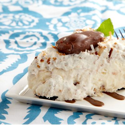 "<p>This rich, creamy, fluffy pie is topped with the most decadent decoration possible — whole candy bars! Recipe Submitted by Real Women of PHILADELPHIA contestant Debbie Fabre.</p> <p><strong>Recipe:</strong> <a href=""../../../recipefinder/mounds-joy-whipped-pie-recipe-kft0212"" target=""_blank""><strong>Mounds of Joy Whipped Pie</strong></a></p>"