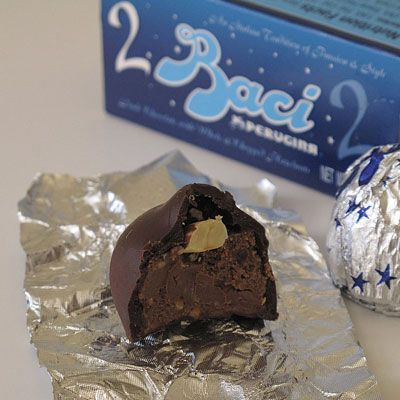"""Hershey's isn't the only one with kisses — Italy has its own version, <a href=""""http://en.wikipedia.org/wiki/Perugina"""" target=""""_blank"""">Perugina's Baci</a>. These chocolate bonbons are filled with hazelnut chocolate cream, topped with a whole hazelnut, and wrapped in a love note."""