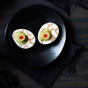 "<p>Setting your sights on a fright-filled party spread? Make sure these creepy peepers — which are egg whites filled with a tangy and tasty mix of avocado and creamy taco sauce — are included.</p> <p><strong>Recipe:</strong> <a href=""/recipefinder/guacamoldy-eyeballs-recipe-123432"" target=""_blank""><strong>Guacamoldy Eyeballs</strong></a></p>"