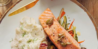 """<p>A simple, flavorful salmon dish perfect for date night, entertaining, or any old weeknight.</p><p><b>Recipe: </b><a href=""""/recipefinder/salmon-parchment-olive-butter-recipe-opr0213"""" target=""""_blank""""><b>Salmon in Parchment with Olive Butter</b></a></p>"""