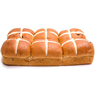 Traditionally eaten in the UK during Easter time, these little buns are flecked with currants or raisins and have a cross etched and/or frosted along the top. Many believe the tradition was started by the Anglo-Saxons, who crossed the buns to honor the four quarters of the moon. Now the cross is widely used to symbolize Jesus' crucifixion.
