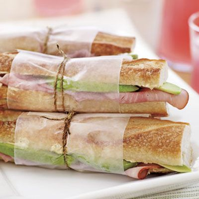"<p>Let the mild, nutty flavor of avocados stand in for Swiss cheese in this classic sandwich. Slather baguettes with a buttery mustard spread, then stuff with avocado and slices of smoky ham.</p> <p><strong>Recipe:</strong> <a href=""../../../recipefinder/avocado-ham-sandwiches"" target=""_blank""><strong>Avocado and Ham Sandwiches</strong></a></p>"