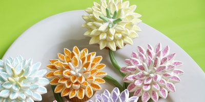 Give dessert a festive floral theme. Cut mini marshmallows on the diagonal and dip the sticky side in colored sugar to make dozens of pink, yellow, purple, blue, and orange mum petals.   Recipe: Mum's the Word Cupcakes