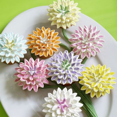 Give dessert a festive floral theme. Cut mini marshmallows on the diagonal and dip the sticky side in colored sugar to make dozens of pink, yellow, purple, blue, and orange mum petals.