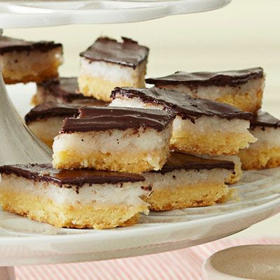 """<p>Rich coconut milk custard is nestled between a layer of toasted coconut crust and smooth chocolate in these decadent bars.</p><p><b>Recipe: <a href=""""/recipefinder/coconut-joy-bars-recipe-ghk1212"""">Coconut Joy Bars</a></b></p>"""