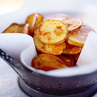 "<p>A sort-of potato chip-French fry hybrid, these oven-baked beauties harness the best of both worlds — crispy outside and all tender bite inside.</p> <p><strong>Recipe:</strong> <a href=""http://www.delish.comrecipefinder/potato-chips-malt-vinegar-recipe-mslo0111""><strong>Potato Chips with Malt Vinegar</strong></a></p>"