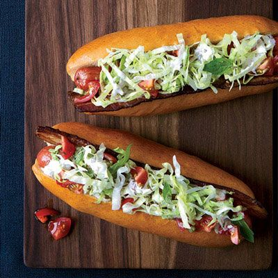 """<p>These """"BLT"""" hot dogs are topped with crispy bacon, fresh tomatoes, and crunchy lettuce dressed with a creamy caraway-pickle mayonnaise.</p><p><b>Recipe: </b><a href=""""http://www.delish.com/recipefinder/blt-hot-dogs-caraway-remoulade-recipe-fw0213"""" target=""""_blank""""><b>BLT Hot Dogs with Caraway Remoulade</b></a></p>"""