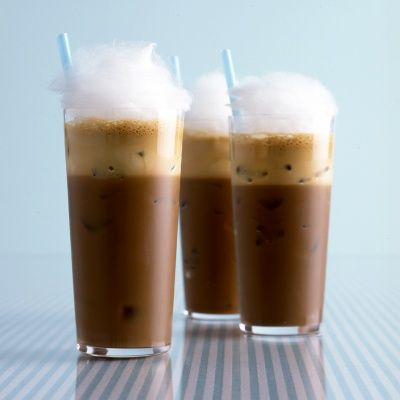 "<p>With layers of texture and full-bodied flavor, this indulgent iced coffee is a rejuvenating treat for a balmy-weather wedding. Once blended, the frappe separates, leaving a frothy cap over the chilled java. It's topped with cotton candy to sweeten each sip.</p> <p><strong>Recipe:</strong> <a href=""../../../recipefinder/iced-coffee-frappe-cotton-candy-recipe-mslo0513"" target=""_blank""><strong>Iced Coffee Frappe with Cotton Candy</strong></a></p>"
