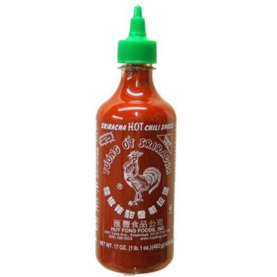 """<p>Sriracha is probably one of the most popular hot sauces currently on the market, and one of the most recognizable, thanks to its now-ubiquitous red rooster label. Made by Huy Fong Foods Inc., this simple but supremely tasty sauce is made from only a few ingredients, like ripe red jalapeño chilies, vinegar, and garlic. Though it has been produced using the same recipe since the 1980s, Sriracha has achieved cult status in recent years, showing up in a multitude of other products, on restaurant menus, and even has two <a href=""""http://www.barnesandnoble.com/s/The-Sriracha-Cookbook?store=allproducts&keyword=The+Sriracha+Cookbook"""" target=""""_blank"""">cookbooks</a> dedicated to it.</p> <p><a href=""""http://www.huyfong.com/no_frames/sriracha.htm"""" target=""""_blank"""">huyfong.com</a></p>"""