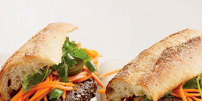 """<p>Topped with Tabasco-spiked mayonnaise, crunchy pickled carrots and jalapeños, and sprigs of cilantro, these burgers showcase the best of American and Vietnamese flavors.</p><p><b>Recipe: <a href=""""/recipefinder/vietnamese-style-banh-mi-burgers-recipe"""" target=""""_blank"""">Vietnamese-Style Bánh Mì Burgers</a></b></p>"""