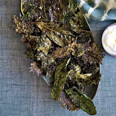"""For an alternative to packaged, dehydrated veggie chips, roast healthy kale with extra-virgin olive oil and garlic until it's crunchy. Serve with lemon-infused Greek yogurt for a low-fat, easy dip. <br /><br /><b>Recipe:</b> <a href=""""/recipefinder/crispy-kale-lemon-yogurt-dip-recipe-fw1010"""" target=""""_blank""""><b>Crispy Kale with Lemon-Yogurt Dip</b></a>"""