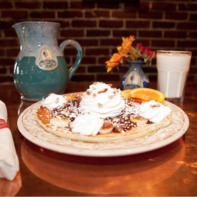 "<p>After a lifetime of working in another sector, Broken Egg founder Ron Green finally found his way to his true calling. He opened the first of many successful Broken Egg establishments on Girod Street in Old Mandeville, Louisiana, in 1994. Since then, Green and his dedicated staff of breakfast enthusiasts have been turning out mind-boggingly addictive breakfasts. We're a huge advocate of their pancakes, included but not limited to the Bananas Foster, which can be made with traditional Buttermilk pancakes, Belgian Waffles, or French Toast. In a nod to New Orleans, these cakes are covered with bananas, pecans, and whipped cream. You will, as a matter of fact, go absolutely bananas for them!</p>  <p><i>Another Broken Egg, 2418 Montevallo Rd., Mountainbrook; (205) 871-7849; <a href=""http://www.anotherbrokenegg.com/wp-content/uploads/2013/03/Menu_Tier3_Birmingham-1.pdf""  target=""_blank"">anotherbrokenegg.com</a></i></p>  <p><b>Homemade Version:</b> <a href=""/recipefinder/banana-pancakes-recipe-mslo1210""><b>Banana Pancakes</b></a></p>"