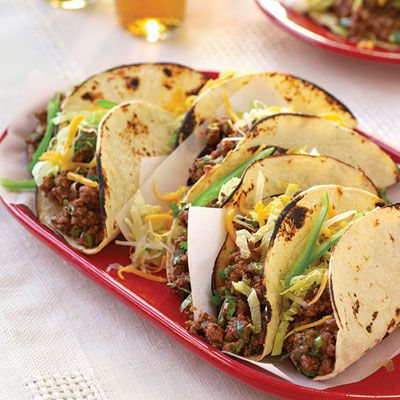 "<p>Chef Daniel Green's answer to the Taco Challenge was to not only swap pork for beef but also to make his own taco shells from soft corn tortillas. Those hard taco shells that come in a box at the grocery store not only are full of fat, sodium, and preservatives, they also crack as soon as you try to stuff them. When you make your own taco shells at home, they're healthier, tastier, and easier to work with. Chef Daniel's tip for a great-tasting and nutritious taco? ""The best tacos get their flavor from the right blend of seasonings, not lots of salt or fat.""</p> <p><strong>Recipe:</strong> <a href=""http://www.delish.com/recipefinder/crispy-beef-tacos-recipe-del0613"" target=""_blank""><strong>Crispy Beef Tacos</strong></a></p>"
