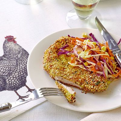 "<p>When Chef Spike Mendelsohn faced off against Chef Laura Vitale to rehab a family's beloved fried chicken recipe, his first order of business was to cut the fat content in half by swapping out the skin-on dark meat in the chicken legs and thighs for skinless, boneless chicken breasts. Then he coated the chicken with egg white, rolled it in cornmeal, and pan-seared it on the stovetop to create that distinctive crunchy exterior, before finishing it off in the oven to keep the meat moist and succulent. A refreshing and colorful vegetable slaw made with red and green cabbage complements this dish and adds a nice dose of vegetables to the plate.</p> <p><strong>Recipe:</strong> <a href=""http://www.delish.com/recipefinder/unfried-chicken-spicy-slaw-recipe–del0613"" target=""_blank""><strong>Unfried Chicken with Spicy Slaw</strong></a></p>"