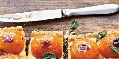 """<p>Don't let basil custard scare you off; topped with roasted apricots, it makes for a gorgeous tart. The tender crust adds to the savory-sweet nature of this dessert.</p> <p><b>Recipe: <a href=""""http://www.delish.com/recipefinder/apricot-basil-shortbread-tart-recipe"""" target=""""_blank"""">Apricot-and-Basil Shortbread Tart</a></b></p>"""