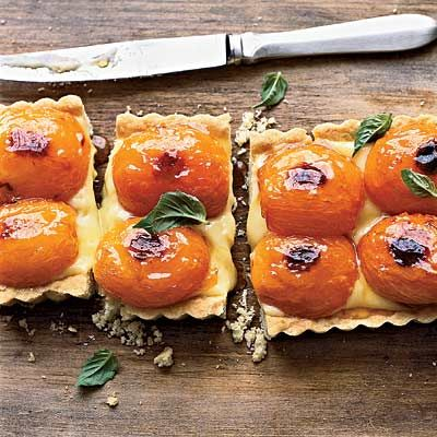"<p>Don't let basil custard scare you off; topped with roasted apricots, it makes for a gorgeous tart. The tender crust adds to the savory-sweet nature of this dessert.</p> <p><b>Recipe: <a href=""http://www.delish.com/recipefinder/apricot-basil-shortbread-tart-recipe"" target=""_blank"">Apricot-and-Basil Shortbread Tart</a></b></p>"