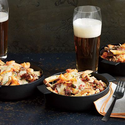 "<p>In chef Kelly English's Southern twist on Canadian poutine, the fries are topped with spicy pimento cheese, andouille gravy, and crawfish, crab, or shrimp.</p><p><b>Recipe:</b> <a href=""http://www.delish.com/recipefinder/louisiana-cheese-fries-crayfish-gravy-recipe-fw1013"" target=""_blank""><b>Louisiana Cheese Fries with Crayfish and Gravy</b></a></p>"