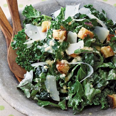 """<p>""""Everywhere I go these days I hear 'kale, kale, kale!' It's the new superfood, so I thought I'd join the bandwagon — but with a twist. Often with raw kale salads there's a lot of chewing involved, which isn't that delightful, so I decided to treat the kale more delicately. I cut out the rib and slice the leaves thinly so they're almost dainty. Drizzle these lovely green ribbons with some super-acidic dressing and this salad doesn't taste like it's good for you — it just taste good! You'll want to hoover this salad down all day long!"""" — Anne Burrell</p> <p><strong>Recipe:</strong> <a href=""""http://www.delish.com/recipefinder/kale-caesar-salad-recipe-del1113""""><strong>Kale Caesar Salad</strong></a></p>"""