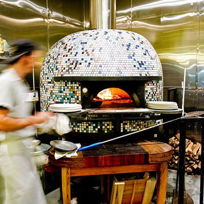 "Located on one of NOLA's best foodie streets, Ancora serves the city's first authentic Neapolitan-style pizza. Chef Jeff Talbot bakes them in his prized multicolored Stefano Ferrara oven. To store toppings near the mouth of the oven, Talbot uses a table made out of old whiskey barrels and designed by Chip Martinson, the husband of F&W Best New Chef 1989 Susan Spicer. Must try: The Bianca, topped with fior di latte (a fresh, creamy mozzarella made from cow milk rather than water buffalo milk), fresh basil, olives, garlic and chile. <br /><br /> <a href=""http://www.ancorapizza.com/"" target=""_blank"">ancorapizza.com</a>"