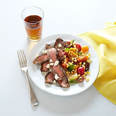 "<p>Simple grilled steak and a salad of sweet corn and juicy tomatoes make an easy and delicious summer meal.</p> <p><strong>Recipe:</strong> <a href=""http://www.delish.com/recipefinder/grilled-flank-steak-garden-salad-recipe-ghk0713"" target=""_blank""><strong>Grilled Flank Steak with Garden Salad</strong></a></p>"