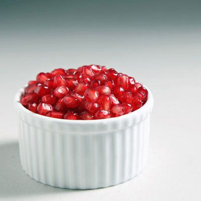 """For many years I avoided <a href=""""http://www.yumsugar.com/Pomegranates-Season-Facts-13111431"""" target=""""_blank"""">buying whole pomegranates</a> for fear of juice splatter reminiscent of a crime scene, instead turning to overpriced, often bland and mushy prepackaged seeds. Since then I've rectified my ways, and realized that a few simple steps are all that separate me from the delicate juicy arils within, hold the mess. Keep reading to learn the tricks to this task."""