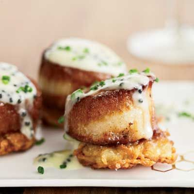 "<p>This elegant pre-dinner bite screams out for a glass of Champagne to top off the rich caviar and bubbly butter sauce spooned on top of luscious scallops. It's New Years Eve wrapped up in an appetizer.</p> <p><strong>Recipe: <a href=""http://www.delish.com/recipefinder/scallops-potato-pancakes-caviar-sauce-recipe"" target=""_blank"">Scallops with Potato Pancakes and Caviar Sauce</a></strong></p>"