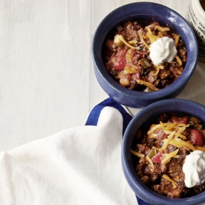 """<p>The secret to this chili with a kick is a generous helping of bourbon and a sprinkle of lemon zest in the sour cream for a fresh, finishing flavor.</p> <p><strong>Recipe: <a href=""""http://www.delish.com/recipefinder/brians-bourbon-chili-recipe-clv1012"""" target=""""_blank"""">Brian's Bourbon Chili</a></strong></p>"""