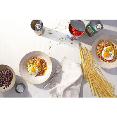 "<p>This recipe takes the genius of combining spaghetti and another dish, à la Cincinnati chili, and adds the popularity of breakfast-for-dinner nights. The rich, runny egg makes a perfect creamy sauce for the rest of the dish.</p> <p><strong>Recipe: <a href=""http://www.delish.com/recipefinder/huevos-rancheros-spaghetti-recipe-opr1012"" target=""_blank"">Huevos Rancheros Spaghetti</a></strong></p>"