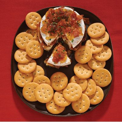 "<p>A fig jam and prosciutto stuffing is the perfect sweet and salty complement to soft, gooey Brie cheese and crunchy crackers.</p> <p><b>Recipe: <a href=""http://www.delish.com/recipefinder/fig-prosciutto-stuffed-brie-recipe-ritz1213"">RITZ Fig and Prosciutto-Stuffed Brie</a></b></p>"
