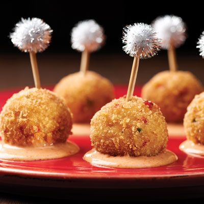 "<p>These flavor-packed jalapeno, pineapple, crab balls are a party within themselves.</p> <p><b>Recipe: <a href=""http://www.delish.com/recipefinder/crab-balls-sriracha-aioli-recipe-ritz1213"">RITZ Crab Balls with Sriracha Aioli</a></b></p>"