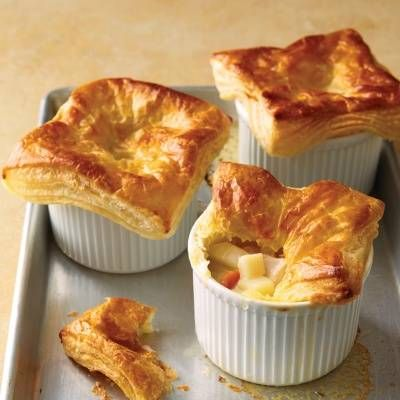 """<p>Rustic potpie turns into an elegant meal when baked in individual ramekins. Top each one with a square of purchased puff pastry and bake until golden, crisp, and piping hot.</p><p><strong>Recipe:</strong> <a href=""""http://www.delish.com/recipefinder/chicken-potpies-puff-pastry-recipe-mslo1113""""><strong>Chicken Potpies with Puff Pastry</strong></a></p>"""