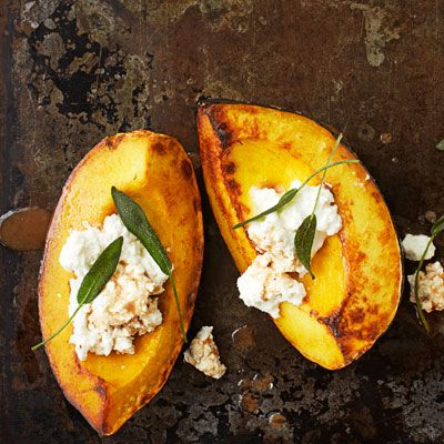 """<p>This side is simply delectable; creamy ricotta and fragrant sage add an elegant touch to sweet roasted squash.</p><p><strong>Recipe:</strong> <a href=""""http://www.delish.com/recipefinder/acorn-squash-ricotta-sage-recipe-opr0113""""><strong>Acorn Squash with Ricotta and Sage</strong></a></p>"""