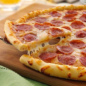 """<p>Adding a meat topping that hikes up pizza's elevated calorie, saturated fat and sodium content increases your heart disease risk. """"A diet high in this 'sometimes' food likely means you aren't consuming enough better-for-you options such as lean protein and heart-healthy fats,"""" explains Stowell. Load up your pizza with veggies instead of meat for more nutrients, and pair it with a big garden salad so you're less tempted to grab another slice.</p>"""