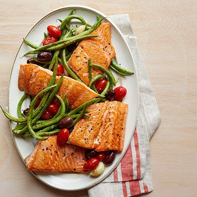 "<p>Salmon's gorgeous color and delicate texture make it an indulgent, naturally-elegant dish you can feel good about eating. This Mediterranean-inspired dish adds just enough olive oil for the health benefits without excessive calories.</p> <p><strong>Recipe: <a href=""http://www.delish.com/recipefinder/roasted-salmon-green-beans-tomatoes-recipe-wdy1013"" target=""_blank"">Roasted Salmon, Green Beans, and Tomatoes</a></strong></p>"